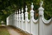 4039548-old-white-picket-fence-in-an-autumn-landscape